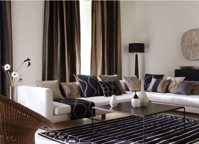 Salón con distintas telas estampadas - Villalba Interiorismo