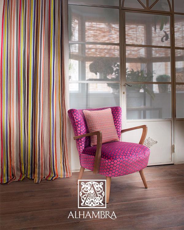 Cortina y tapiceria con telas del catálogo de Alhambra - Villalba Interiorismo