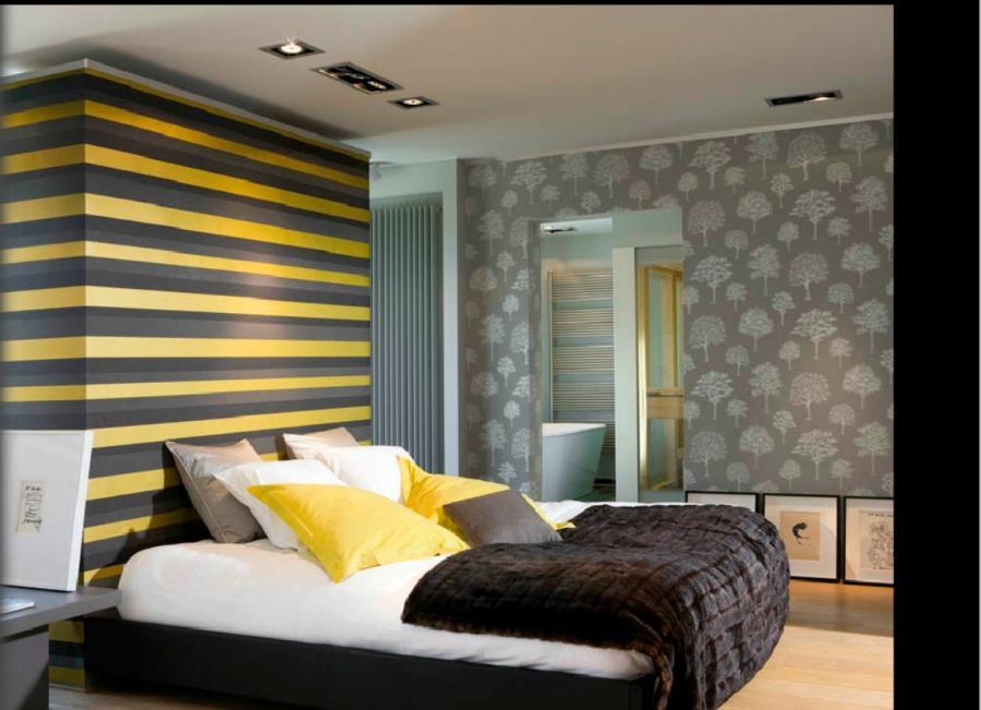 Dormitorio color gris con amarillo - Villalba Interiorismo