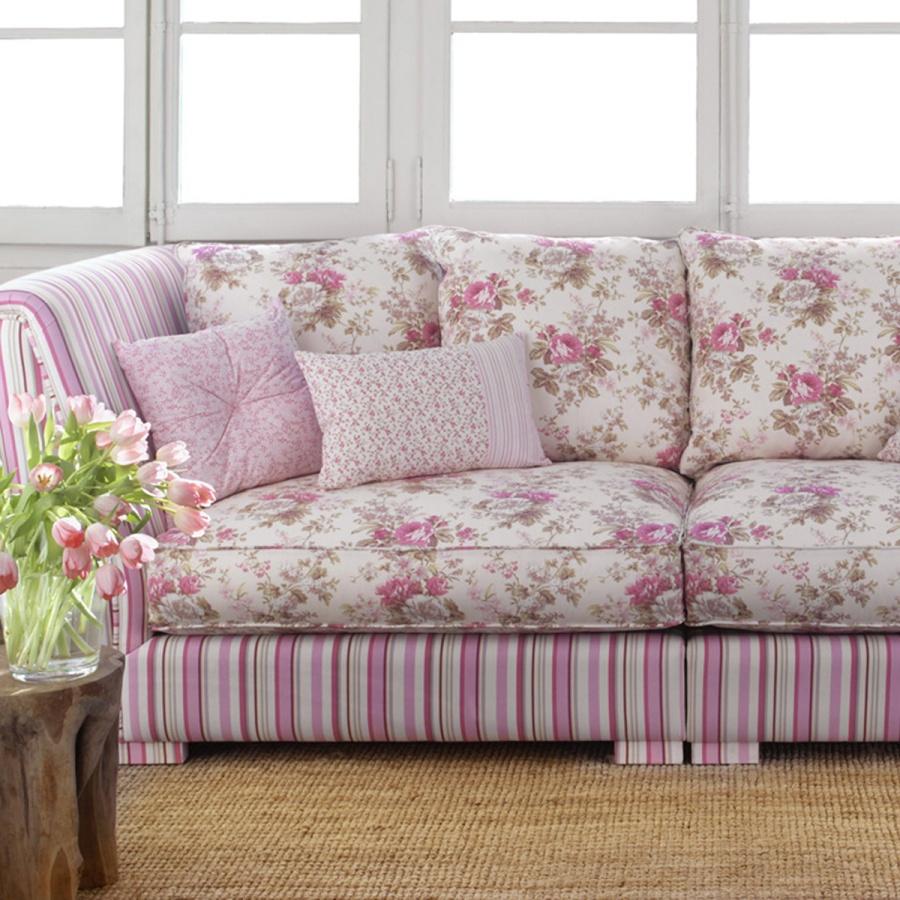Sofá tapizado con tela de flores - Villalba Interiorismo
