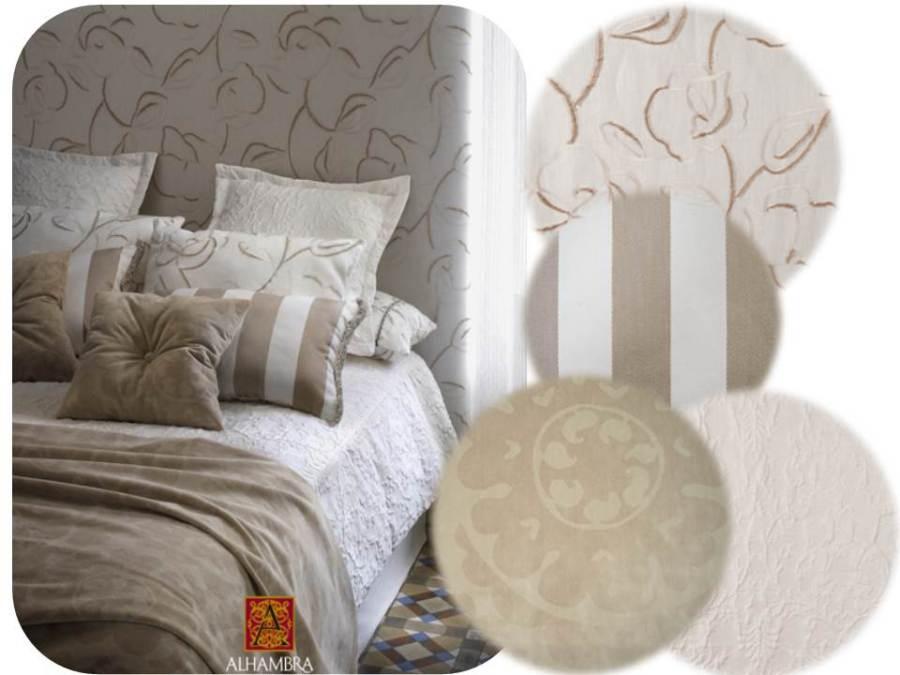 Cojines con distitnas texturas y dibujos - Villalba Interiorismo