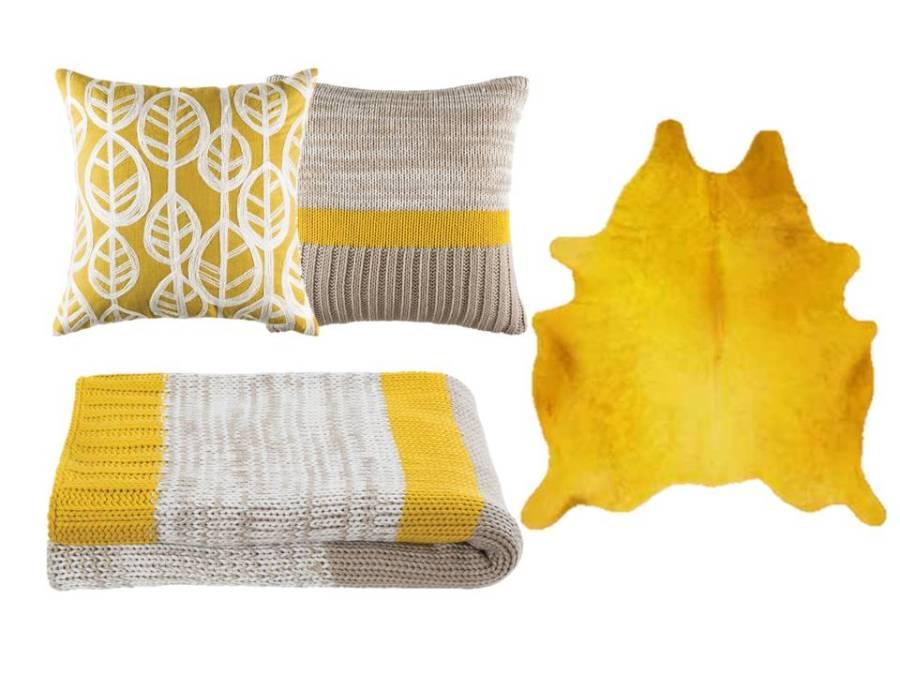 Manta, cojines y alfombra en amarillo - Villalba Interiorismo