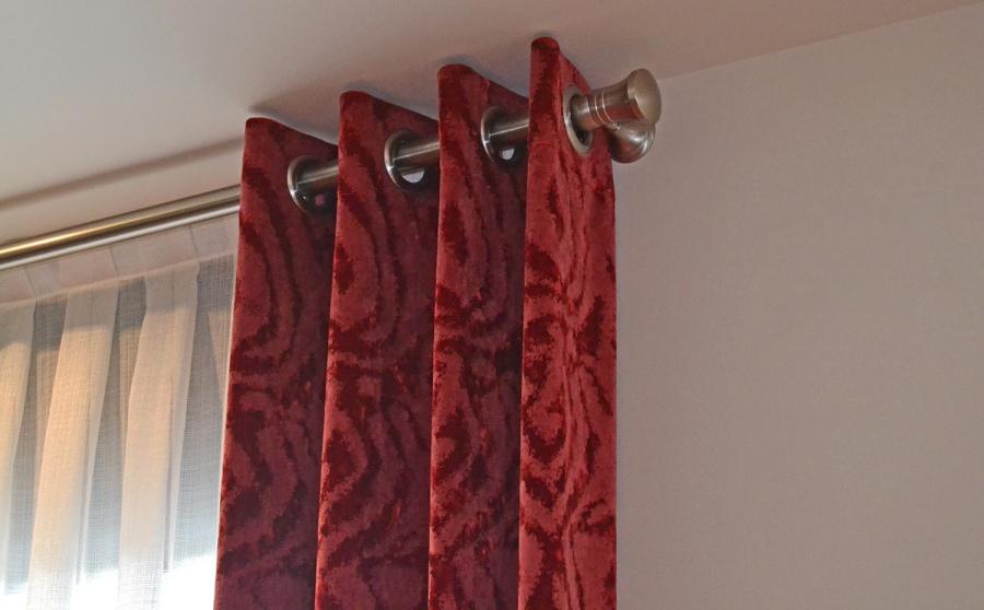 Dobles cortinas con ollaos - Villalba Interiorismo