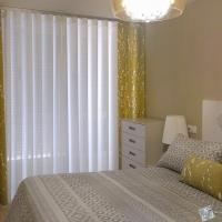 Dobles cortinas colocadas en un riel de onda perfecta